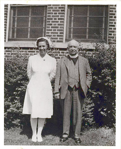 Rev. Calvin with Nurse at the Sanitorium