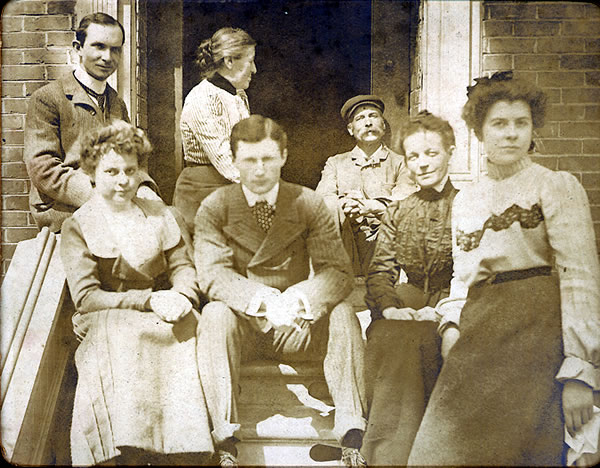 young calvin and people on steps(Rev. Calvin McQuesten is in the upper left)