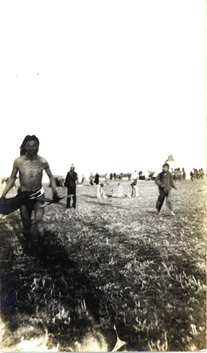 A Blackfoot native, likely from Alberta.  This photo may have been taken while Calvin was observing the sun dance ritual (c. 1904).  His article is available online, see Box 14-099.